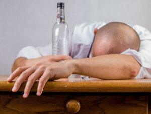 Man suffering from a hangover, Food To Detox The Body